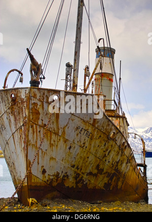The old Whaler, Petrel, now beached and rusting, at the whaling station at Grytviken, South Georgia.Grytviken is - Stock Photo