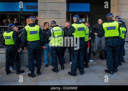 London, UK. 15th October 2013. Police perform stop and search procedures on Polish fans at Westminster prior to - Stock Photo