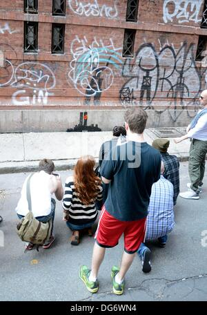 New York, NY, USA. 15th Oct, 2013. Banksy out and about for Graffiti Artist Banksy Tags 9/11 Twin Towers Tribute - Stock Photo