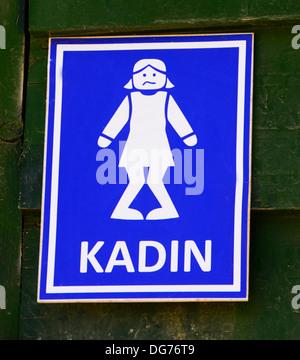 humorous public lavatory sign (Turkish) - Stock Photo