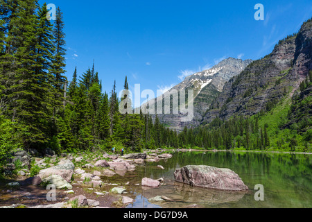 Hikers on the shore of Avalanche Lake, Glacier National Park, Montana, USA - Stock Photo