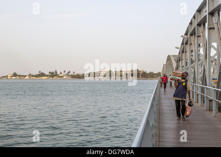 Senegal, Saint Louis. Pedestrians on the Pont Faidherbe, Bridge over the River Senegal. Built 1897. - Stock Photo
