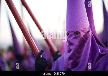Penitent bearing candle, Good Friday, Seville, Spain - Stock Photo