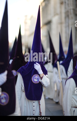 Hooded penitents bearing candles, Holy Week 2008, Seville, Spain - Stock Photo