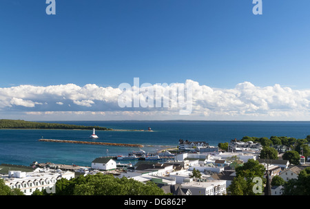 Mackinac Island Michigan looking down on city from the fort. There are two lighthouses in the harbor. - Stock Photo