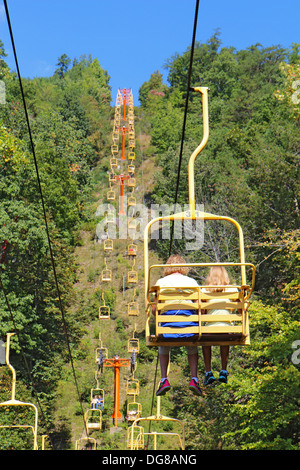 Tourists on the Sky Lift chair ride near River Road in Gatlinburg, Tennessee vertical - Stock Photo