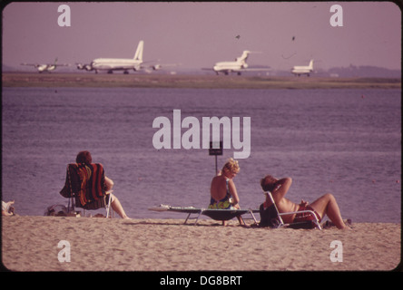 CONSTITUTION BEACH-WITHIN SIGHT AND SOUND OF LOGAN AIRPORT'S TAKEOFF RUNWAY. 22R 548468 - Stock Photo