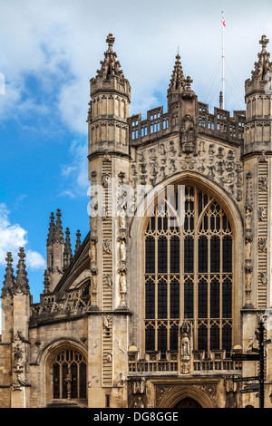 Part of the Gothic west front of Bath Abbey with tourist signs in the right corner. - Stock Photo