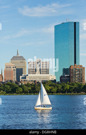 Skyline (200 Clarenton, formerly known as Hancock Tower in glass) and sailboat on Charles River, Boston, Massachusetts - Stock Photo