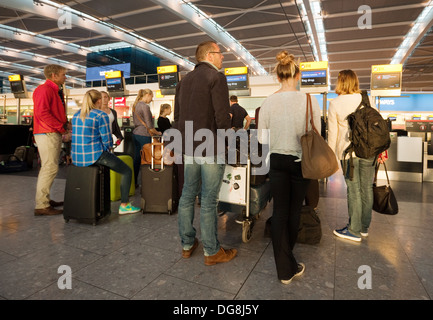 People in a queue at the Check in, Terminal 5, Heathrow airport London UK - Stock Photo