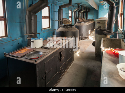 Interior of old railway wagon kitchen - Stock Photo