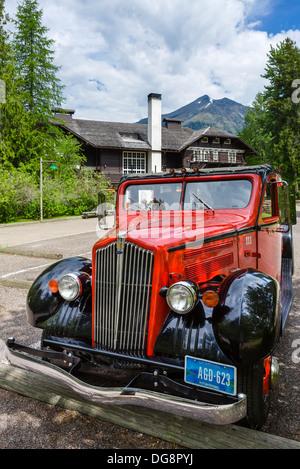 Red Bus Tour bus outside the Lake McDonald Lodge, Glacier National Park, Montana, USA - Stock Photo