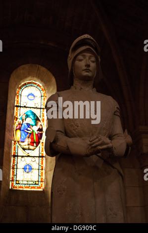 Statue of Sainte Jean d'Arc inside the church of Sainte-Croix-du-Mont in the Bordeaux wine region of France - Stock Photo
