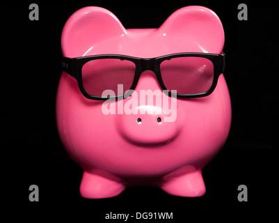Piggy bank wearing 3D glasses studio cutout