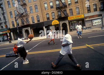 New York, NY - August 1994 - Children play ball during a street fair in West Harlem. Rally to Stop the Violence. - Stock Photo