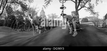 New York, NY Circa 1987 - Widelux panorama of children playing on the Hills in Washington Square Park - Stock Photo