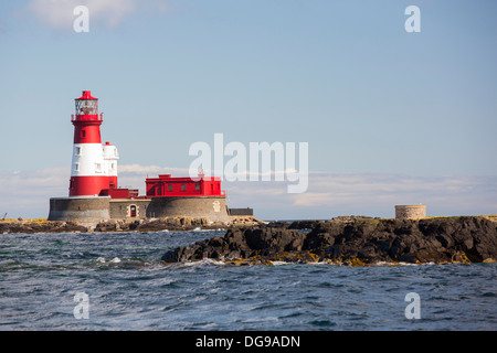 Longstone lighthouse on the Farnes Islands, off Seahouses in Northumberland, from where Grace Darling made her famous - Stock Photo