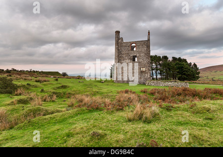 An old ruined engine house for a tin mine at Minions on Bodmin moor in Cornwall - Stock Photo