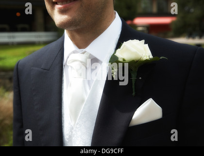 Groom with flower in buttonhole on suit. - Stock Photo