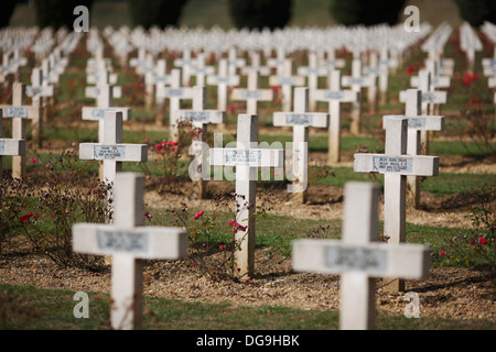 Crosses marking the graves of French soldiers in the military cemetery at the Ossuaire de Douaumont near Verdun - Stock Photo