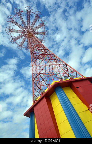 The Parachute Jump in Coney Island known as the Eiffel Tower of Brooklyn photographed against a cloud filled sky. - Stock Photo