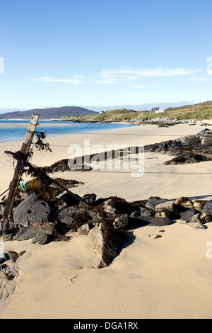 Old Fencepost and Rocky outcrop on Luskentyre beach Isle of Harris Western Isles Scotland UK - Stock Photo