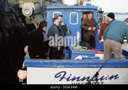 Fishermen at port. Clew Bay, Westport, Co. Mayo. Ireland - Stock Photo