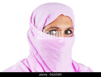 Portrait of serious middle aged muslim woman with pink scarf or hijab - Stock Photo