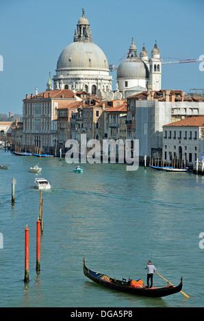 Santa Maria Della Salute church and gondola on Grand Canal, view from Academia Bridge, Venice, Italy - Stock Photo