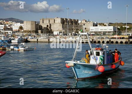 Boats in fishing port and castle of Guzman el Bueno, Tarifa, Cadiz province, Andalusia, Spain - Stock Photo