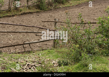 A wood rail fence next to a farmers field near Cotacachi, Ecuador - Stock Photo