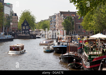 Ships in the canal in Amsterdam - Stock Photo