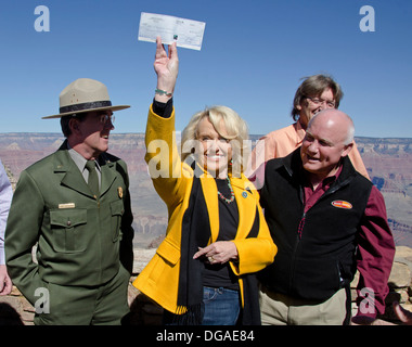 Arizona Governor Jan Brewer hold up the check for $426,500 from her state that will be used to re-open the Grand - Stock Photo