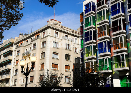 Art Deco façade of the Hotel Hesperia Bilbao crystals with different colored windows as opposed to a classical building - Stock Photo