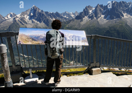 An older woman reading an information panel at le Brevent, Chamonix, Mont Blanc - Stock Photo