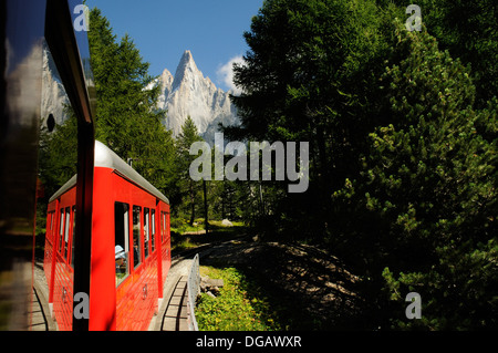 The aiguille de Dru and Montenvers seen from inside the Montenvers funicular railway, Chamonix, France - Stock Photo
