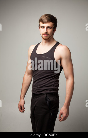 Athletic young male model in T-shirt. - Stock Photo