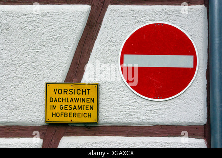 German Warning Sign Attention Roof Avalanche And Drive Through Prohibited - Stock Photo