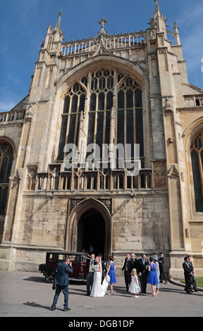 Bride and groom and the family bridal group outside Gloucester Cathedral, Gloucester, Glous, UK. - Stock Photo