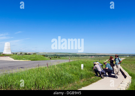 Tourists photographing a grave marker near Last Stand Hill, Little Bighorn Battlefield National Monument, Montana, - Stock Photo