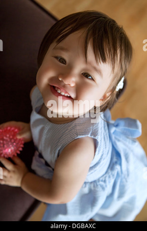 19 months old smiling baby girl - Stock Photo
