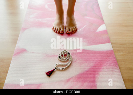 Yoga practice with Buddhist Mala - Stock Photo