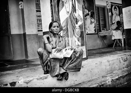 Indian woman patient with facial skin graft scars waiting at Sathya Sai Baba mobile outreach hospital. Andhra Pradesh, - Stock Photo