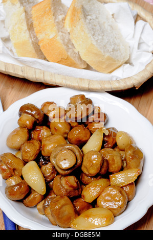 Tapas - Whole button mushrooms and garlic cloves with bread, Andalusia, Spain, Western Europe. - Stock Photo