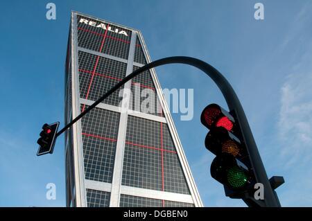 KIO Tower and red traffic light. Plaza de Castilla, Madrid, Spain. - Stock Photo