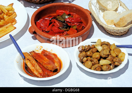 Spanish tapas selection of Mackerel, Mushrooms and red peppers, Andalusia, Spain, Western Europe. - Stock Photo