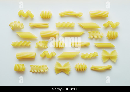 Different types of pasta on white background wallpaper - Stock Photo