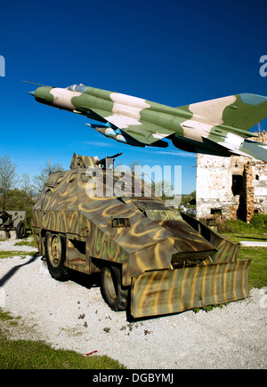 Military vehicle Armoured personnel carrier and Croatian air forces MIG 21 airplane in Turanj war museum, Croatia, - Stock Photo