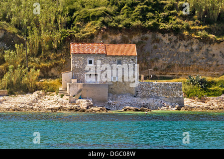 Stone house on the beach in dalmatian Island of Susak, Croatia - Stock Photo