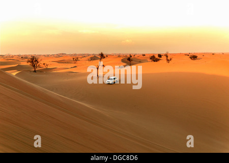 Off road vehicle in desert, Adu Dhabi, United Arab Emirates - Stock Photo
